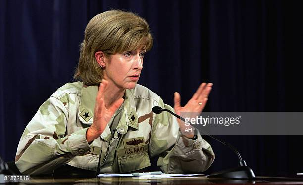 US Rear Admiral Kathleen M Dussault commander of the Joint Contracting Command Iraq/Afghanistan gestures as she speaks during a joint press...