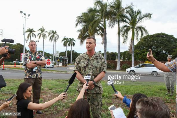 Rear Admiral Robert Chadwick answers questions at a press conference outside of the Nimitz Gate entrance to Joint Base Pearl HarborHickam on December...