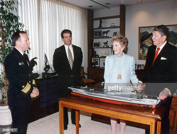 Rear Admiral Robert M Nutwell Commander US Navy Carrier Group 3 and Newport News President and CEO William P Fricks standing w Nancy Reagan and...