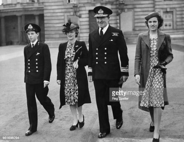Rear Admiral Sir Harold Burrough of the Royal Navy leaves Buckingham Palace in London after receiving the KBE and DSO with his wife Lady Burrough his...