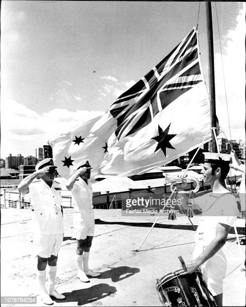 Rear Admiral W J Dovers CBE DSC Flag officers Commanding East Australia Area and Commander AA Evans Commanding officer of the HMAS Sydney salute as...