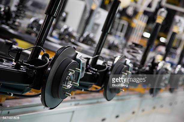 Rear axles for Hyundai Motor Co. Elantra vehicles and Ioniq electric vehicles sit on the production line at the company's plant in Ulsan, South...