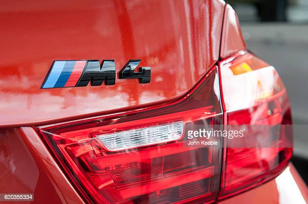 A rear BMW M4 logo badge next to the rear indicator lights on October 20 2016 in Southend United Kingdom
