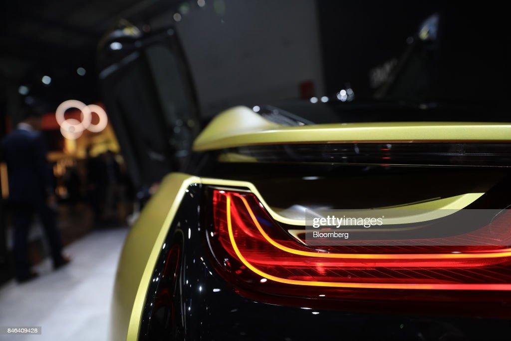A Rear Brake Light Sits Illuminated On A Bmw I8 Electric Automobile