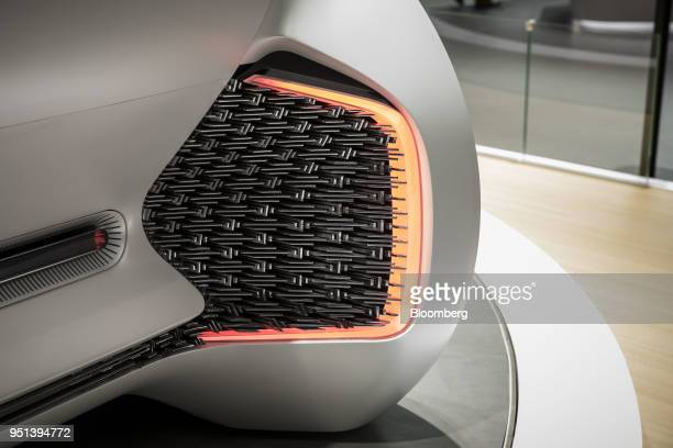 A rear brake light sits on a Chongqing Changan Automobile Co Oshan Nu Age concept vehicle as it stands on display at the Beijing International...