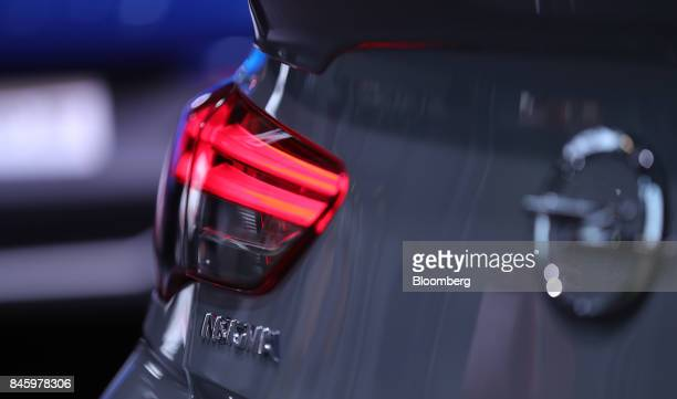 A rear brake light sits on an Opel AG Insignia automobile manufactured Adam Opel AG a unit of the PSA Group during the first media preview day of the...