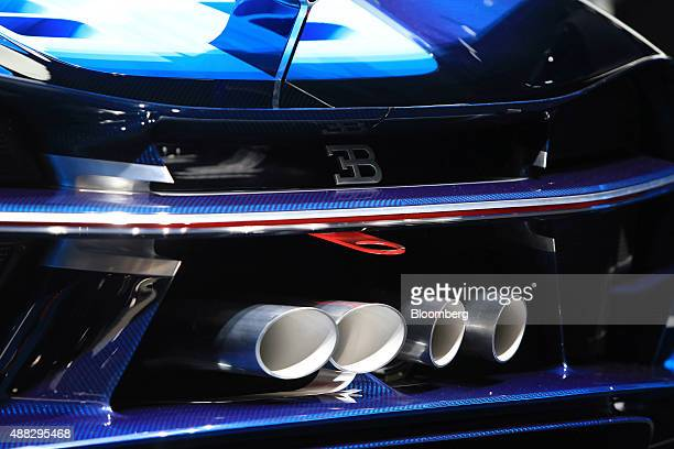 Rear exhaust pipes sit on a luxury Bugatti Vision Gran Turismo sports automobile produced by Volkswagen AG during previews to IAA Frankfurt Motor...