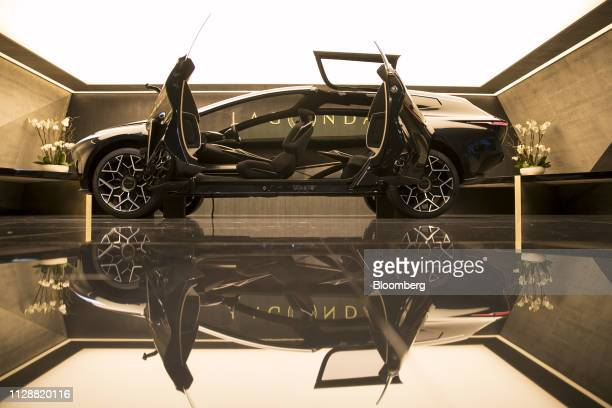 Rear hinged doors sit open on an Aston Martin Lagonda All Terrain concept sportsutility vehicle on day two of the 89th Geneva International Motor...
