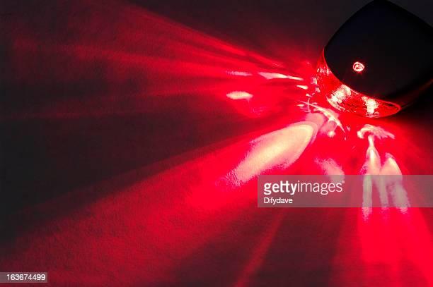 Rear LED Bicycle Light Lighting Up Background