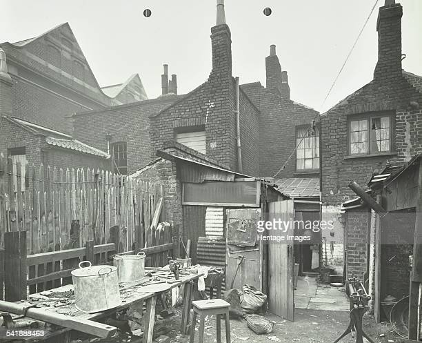 Rear of houses prior to slum clearance Princess Road Lambeth London 1914 Artist unknown