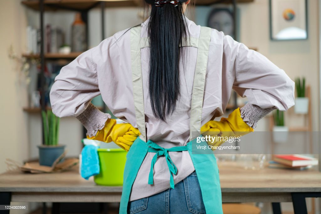 rear of housewife wear apron ready to cleansing home : Stock Photo