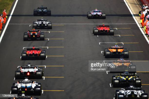 Rear view as Lewis Hamilton of Great Britain driving the Mercedes AMG Petronas F1 Team Mercedes W11 leads the field off on the formation lap during...