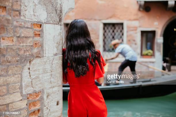 rear view beautiful brunette woman posing in venice - venice stock pictures, royalty-free photos & images