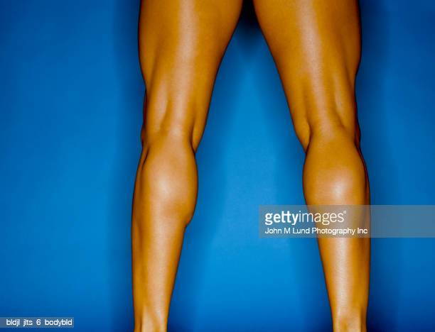Rear view close-up of the muscles on a young woman's legs