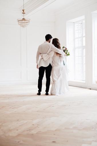 Rear View Full Length Of Bride And Bridegroom Standing In Room - gettyimageskorea