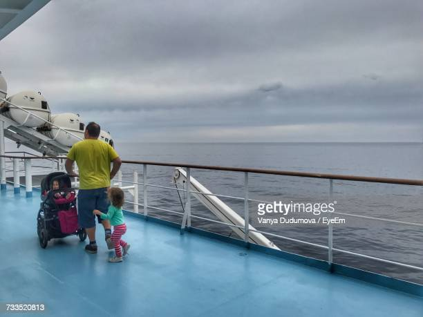 rear view full length of father with children in cruise ship at sea - paquebot france photos et images de collection