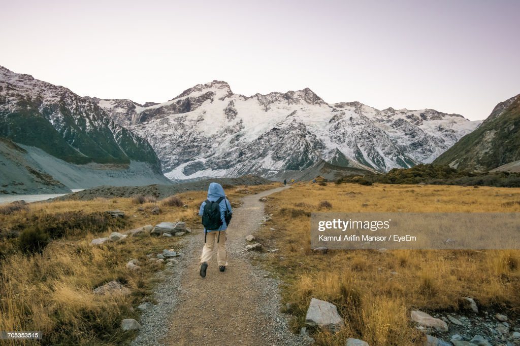 Rear View Full Length Of Hiker At Mt Cook National Park During Winter : Stock Photo