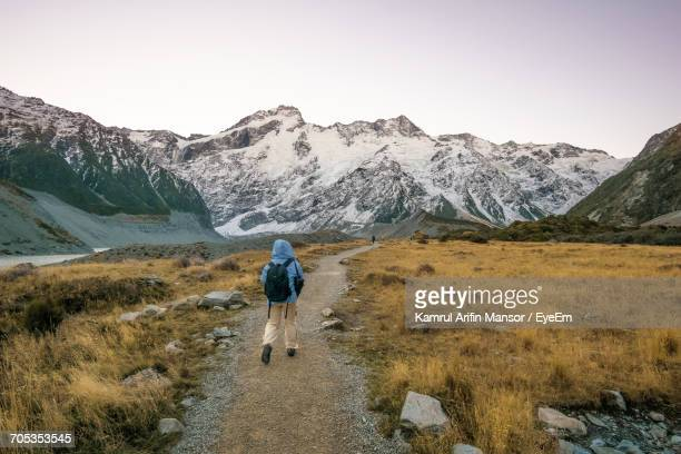 Rear View Full Length Of Hiker At Mt Cook National Park During Winter
