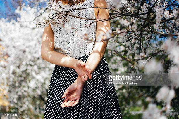 Rear View Midsection Of Woman In Springtime