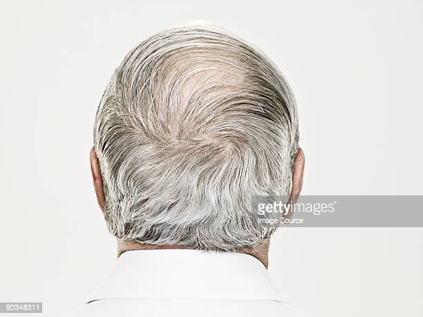 rear view of a balding senior man - gray hair stock pictures, royalty-free photos & images