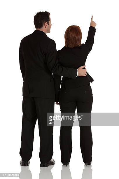Rear view of a business couple standing