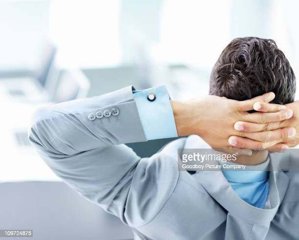 Rear view of a businessman relaxing in the office