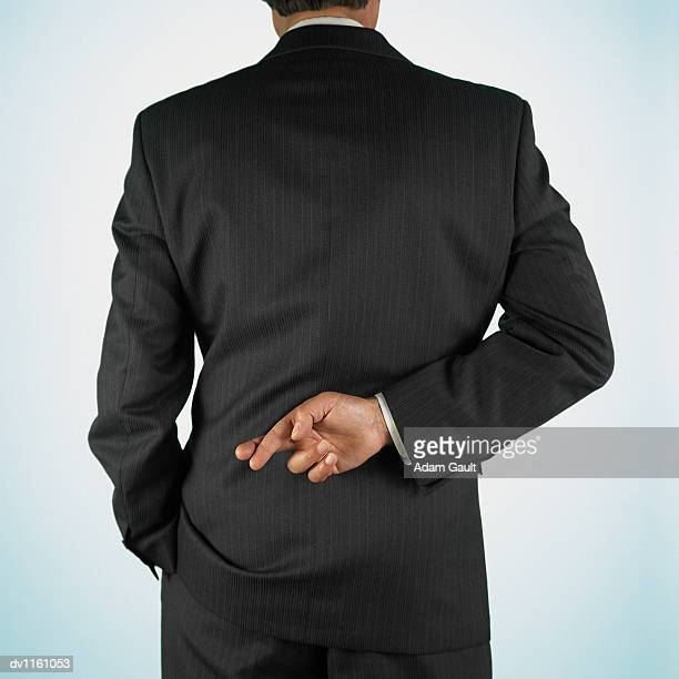 Rear View of a Businessman With His Fingers Crossed Behind His Back