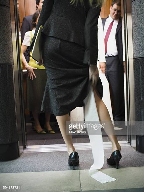 rear view of a businesswoman entering an elevator - funny toilet paper stock pictures, royalty-free photos & images