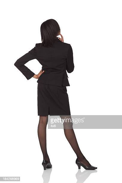 Rear view of a businesswoman standing in thoughtful pose