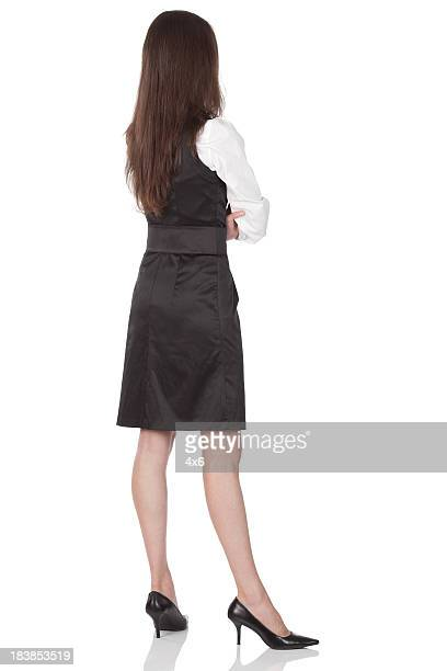 Rear view of a businesswoman standing with arms crossed