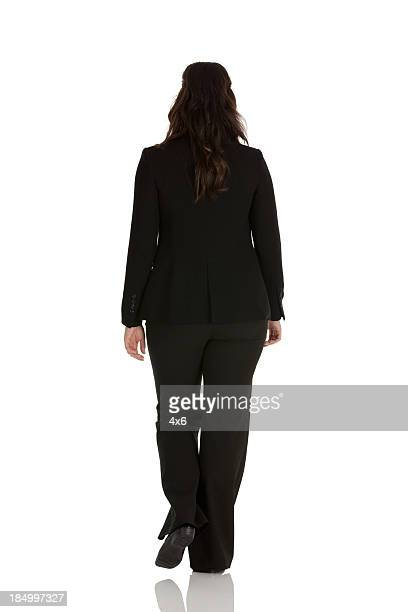 Rear view of a businesswoman walking