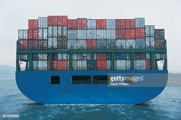 Rear View of a Cargo Ship Transporting Containers