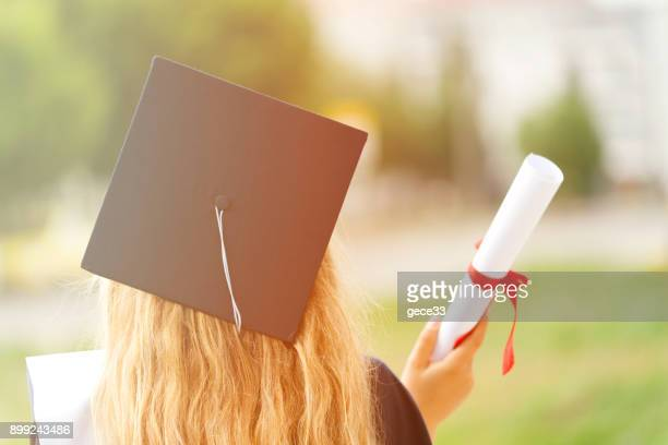 rear view of a college graduate - diploma stock photos and pictures