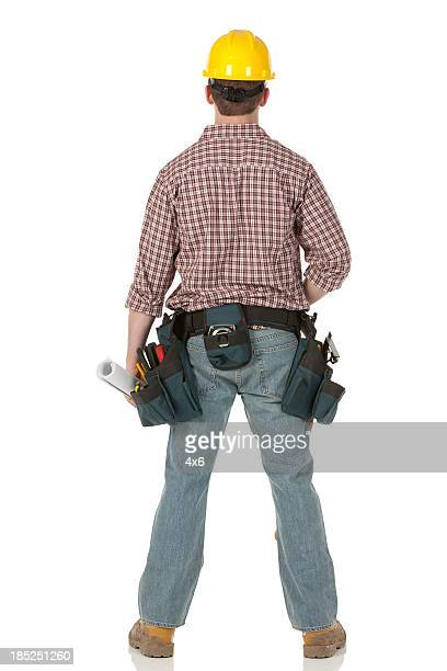 Rear view of a construction worker standing