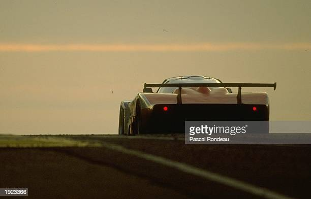 Rear view of a Cougar Porsche at dusk during the Le Mans 24 hour race in Le Mans France Mandatory Credit Pascal Rondeau/Allsport