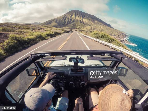 rear view of a couple driving in a convertible, lahaina, maui, hawaii, america, usa - road trip stock photos and pictures