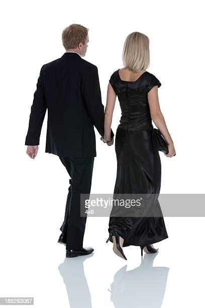 Rear view of a couple walking