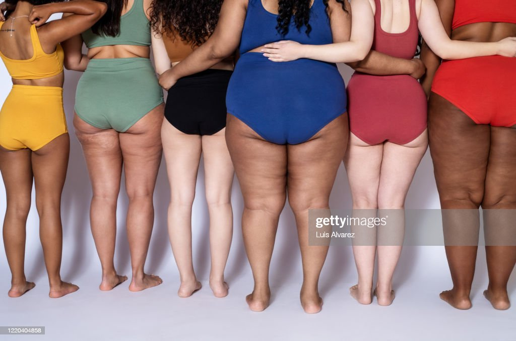 Rear view of a diverse females together in underwear : Stock Photo
