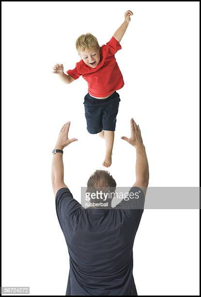 Rear view of a father catching his son