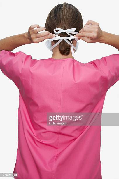 Rear view of a female doctor wearing a surgical mask