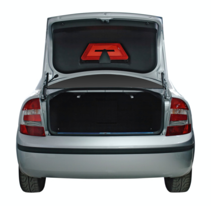 Rear view of a generic car with an open trunk 93277067