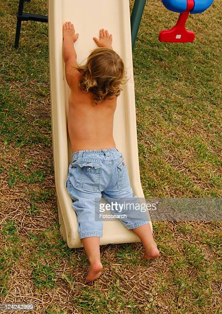 Rear view of a girl on a slide