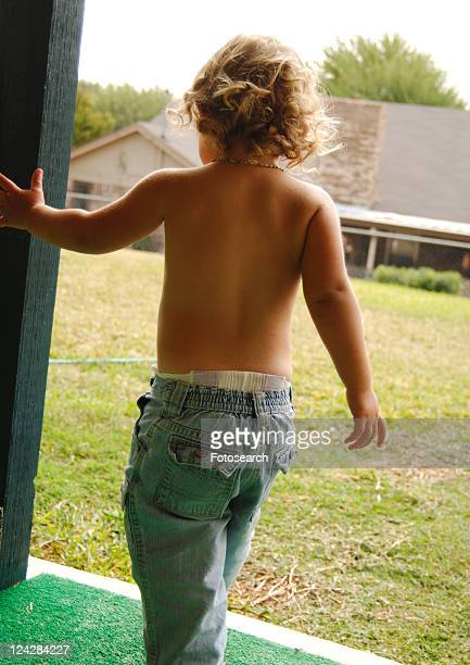 rear view of a girl walking - little girls bare bum stock pictures, royalty-free photos & images