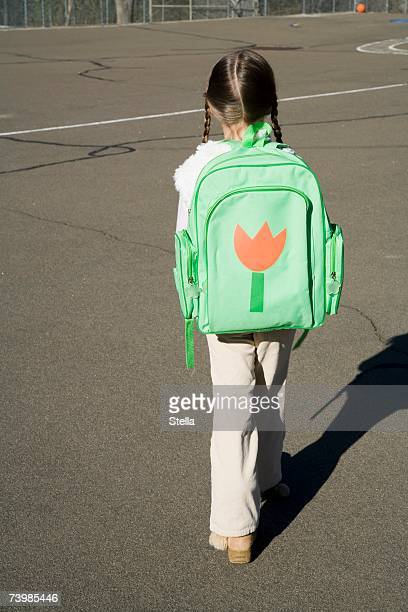 Rear view of a girl with a rucksack