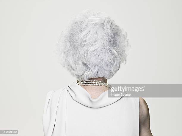 Rear view of a gray haired senior woman