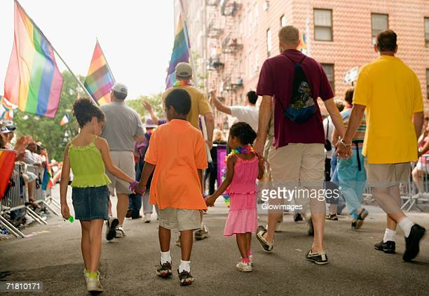 Rear view of a group of people walking at a gay parade