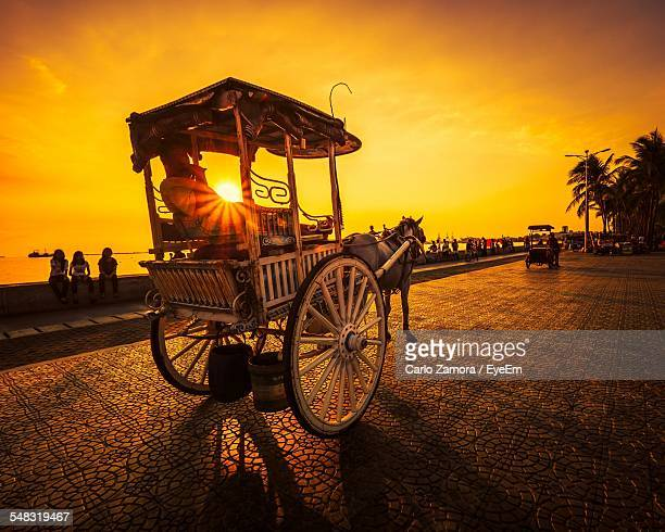 rear view of a horse carriage on street - manila philippines stock pictures, royalty-free photos & images