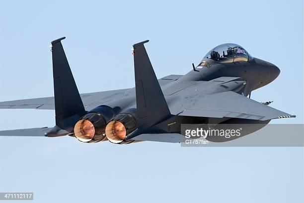 Rear view of a jet fighter in flight