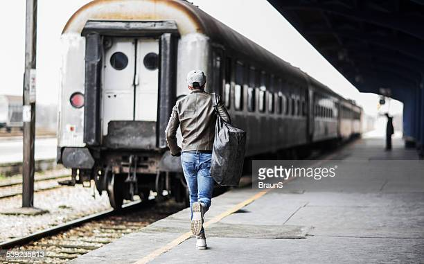 Rear view of a man catching the train.