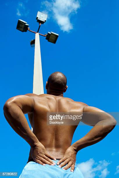 Rear view of a man exercising